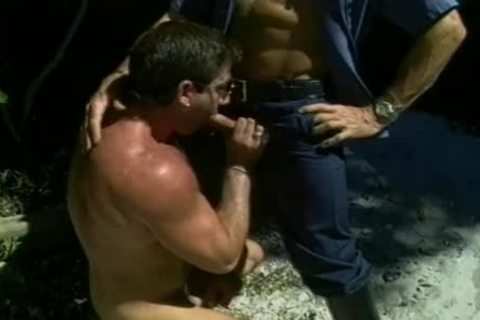 Two delicious Cops acquire A man On His Knees To suck wang