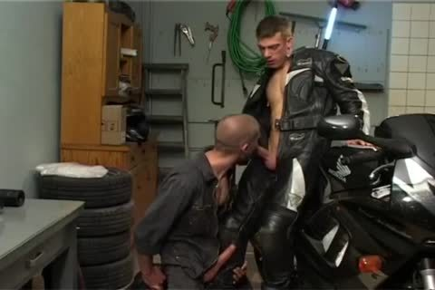 Biker plowing Car Mechanic