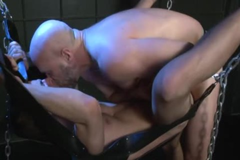 A Father pokes His Son In A Sling