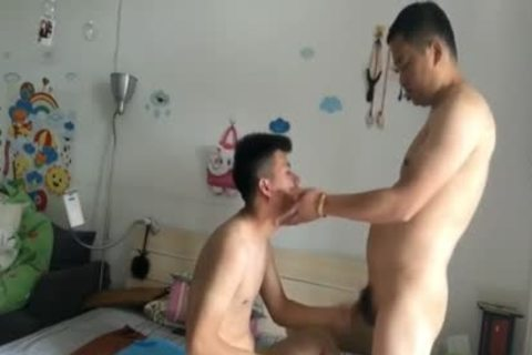 Chinese chap plows Chinese lad